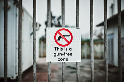 """Buy stock photo Shot of a sign on a fence saying """"This is a gun-free zone"""""""