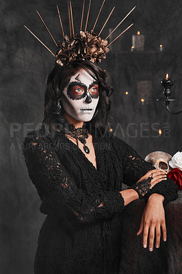 Buy stock photo Cropped shot of an attractive young woman dressed in her Mexican-style halloween costume