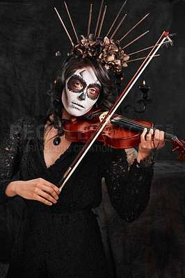Buy stock photo Cropped portrait of an attractive young woman dressed in her Mexican-style halloween costume playing a violin