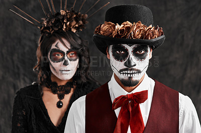 Buy stock photo Cropped portrait of an affectionate young couple dressed in their Mexican-style halloween costumes