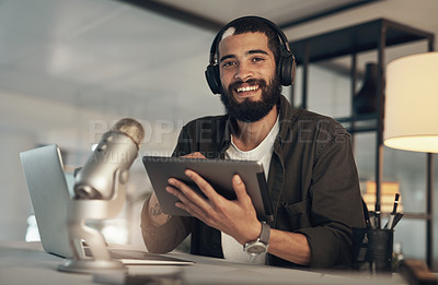 Buy stock photo Shot of a young man using a headset, microphone and digital tablet during a late night at work