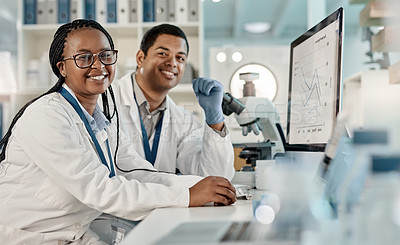 Buy stock photo Portrait of two scientists working together on a computer in a lab