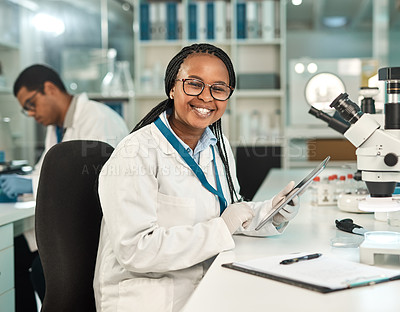Buy stock photo Portrait of a young scientist using a digital tablet in a lab