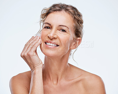 Buy stock photo Shot of a mature woman holding a cotton pad against her face