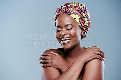 Buy stock photo Studio shot of a beautiful young woman posing against a grey background