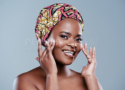Buy stock photo Studio portrait of a beautiful young woman applying face lotion against a grey background