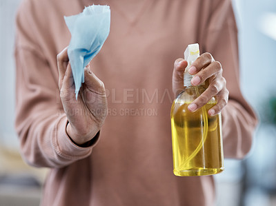 Buy stock photo Shot of an unrecognisable woman using wipes and disinfectant while working from home