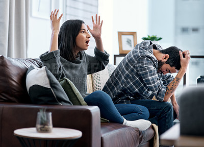 Buy stock photo Shot of a young couple looking upset while watching tv together at home