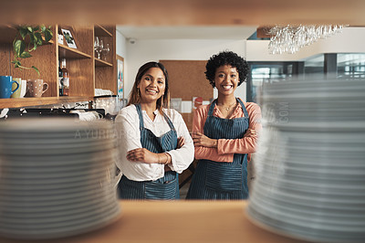 Buy stock photo Cropped shot of two young women working in a cafe