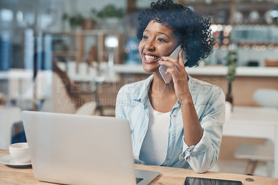 Buy stock photo Shot of a businesswoman talking on her cellphone while working from a cafe