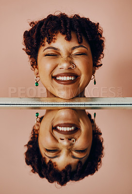 Buy stock photo Cropped shot of a woman's head reflecting in a mirror in front of her
