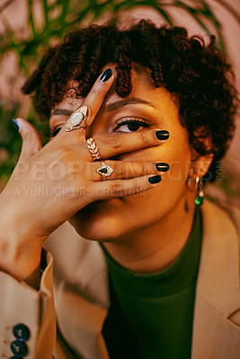 Buy stock photo Cropped shot of a beautiful young woman posing with her hand on her face