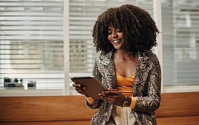 Buy stock photo Shot of a young businesswoman using a digital tablet in an office
