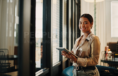 Buy stock photo Portrait of a confident young businesswoman working in an office