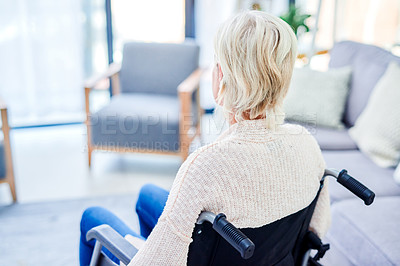 Buy stock photo Rearview shot of a senior woman using a wheelchair at home