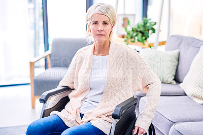 Buy stock photo Portrait of a senior woman using a wheelchair at home