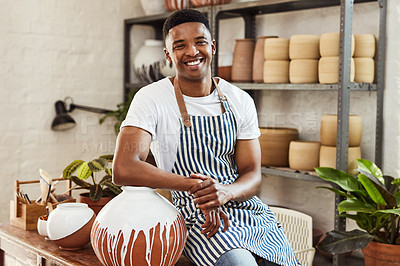 Buy stock photo Portrait of a confident young man working in a pottery studio