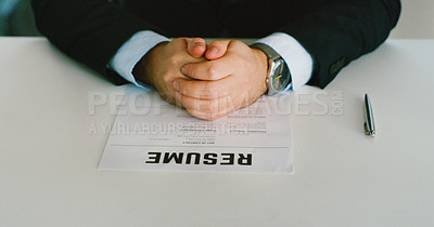Buy stock photo Shot of an unrecognisable businessman going over a resume in a modern office
