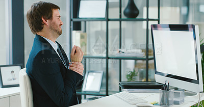 Buy stock photo Shot of a young businessman experiencing wrist pain while using a computer in a modern office