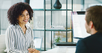 Buy stock photo Shot of a young businessman and businesswoman having a discussion in an office