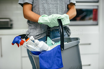 Buy stock photo Closeup shot of an unrecognisable woman holding a bucket of cleaning detergents at home