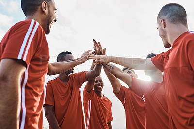 Buy stock photo Shot of a team of soccer players giving each other a high-five after their match