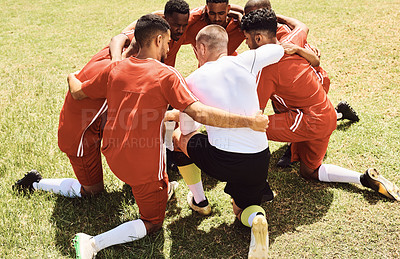 Buy stock photo Shot of a group of players having a discussion on the field