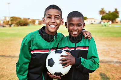 Buy stock photo Portrait of two young boys playing soccer on a sports field