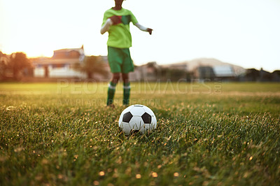 Buy stock photo Closeup shot of a young boy playing soccer on a sports field