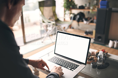 Buy stock photo Cropped shot of an unrecognisable man using a laptop at home