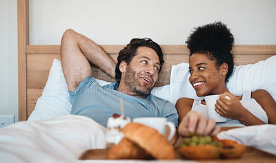 Buy stock photo Cropped shot of a couple having breakfast in bed