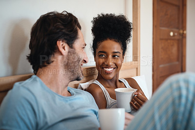 Buy stock photo Cropped shot of a couple having coffee while lying in bed