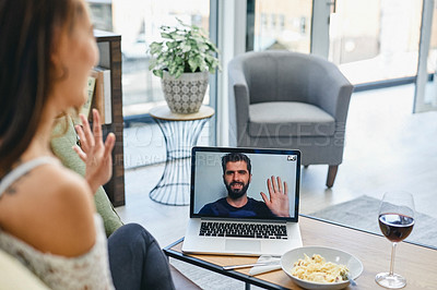 Buy stock photo Shot of a woman having dinner while on a video call on her laptop