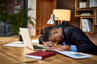Buy stock photo Shot of businessman sleeping at his desk in a modern office