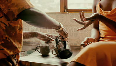 Buy stock photo Shot of an unrecognisable couple having coffee together in the kitchen at home