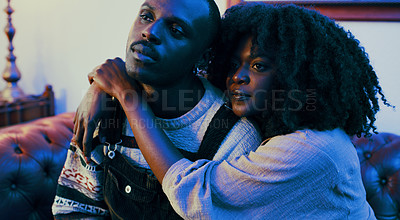 Buy stock photo Shot of a young couple relaxing on the sofa at home