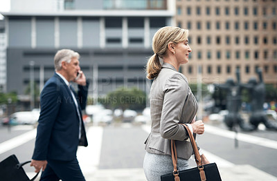 Buy stock photo Shot of a mature businesswoman walking in the city