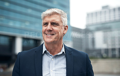 Buy stock photo Shot of a mature businessman walking in the city