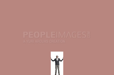 Buy stock photo Shot of a businessman caged in against a coloured background