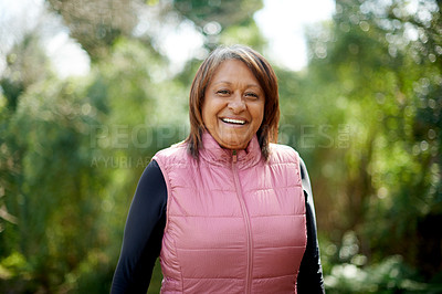 Buy stock photo Shot of a mature woman going for a hike in nature