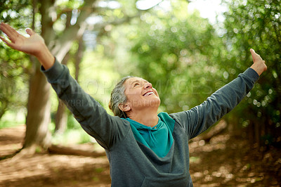 Buy stock photo Shot of a mature woman celebrating while out hiking in nature