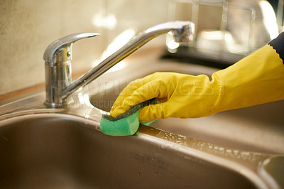 Buy stock photo Cropped shot of an unrecognizable woman cleaning the kitchen sink