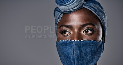 Buy stock photo Shot of a beautiful young woman wearing a denim head wrap and mask