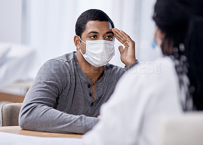 Buy stock photo Shot of a young man having a consultation with a doctor