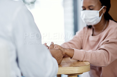 Buy stock photo Closeup shot of an unrecognisable doctor holding hands with a patient during a consultation