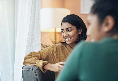 Buy stock photo Cropped shot of two young women sitting together at home