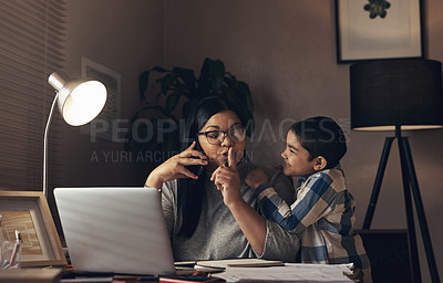 Buy stock photo Shot of an adorable little boy demanding his mother's attention while she works at home