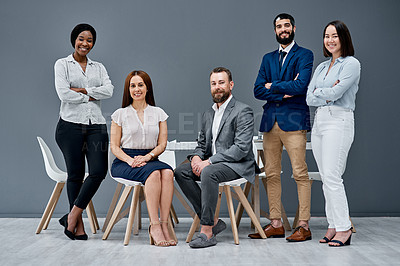 Buy stock photo Portrait of a group of businesspeople posing together against a grey background