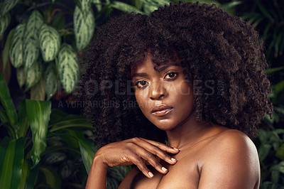 Buy stock photo Shot of a beautiful young woman posing against a leafy background