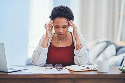 Buy stock photo Cropped shot of a stressed young lady working from home at her desk